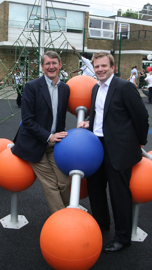 David Walden and I hog a piece of the new playground equipment