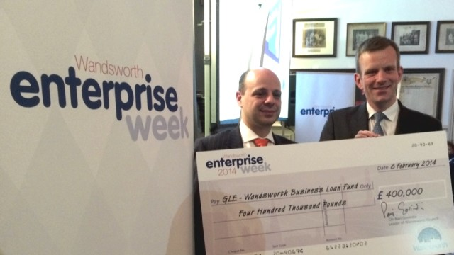 Presenting the cheque to launch the Business Loan Fund