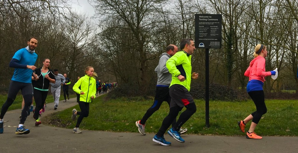 Runners take the final bend of the three-lap Tooting parkrun route