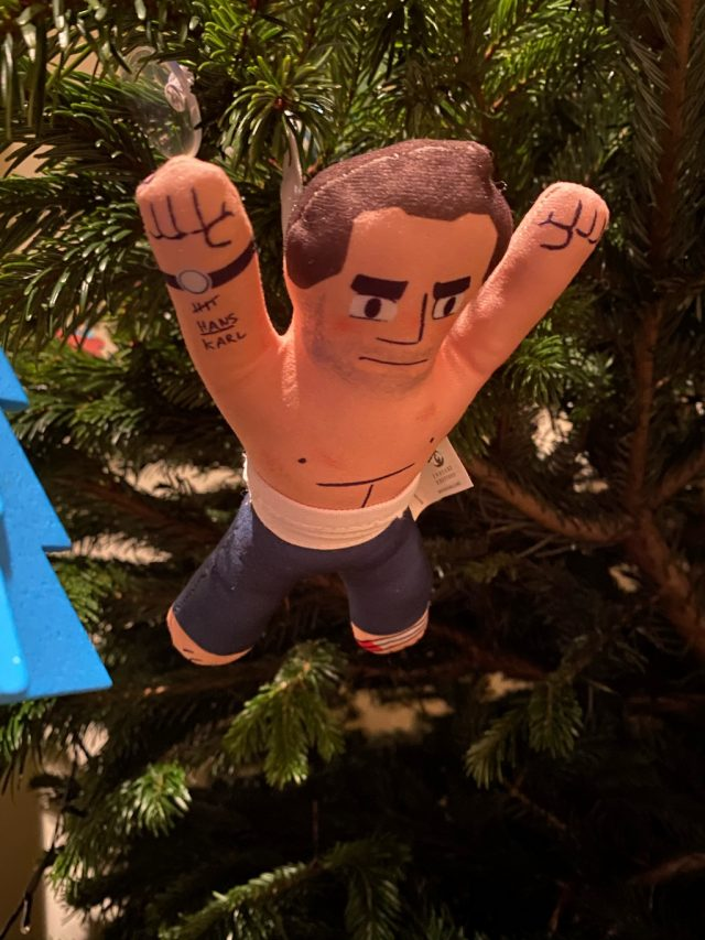 John McClane plushie toy jumping from the Christmas tree